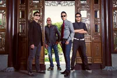 A photo of the four members of the band The Slants