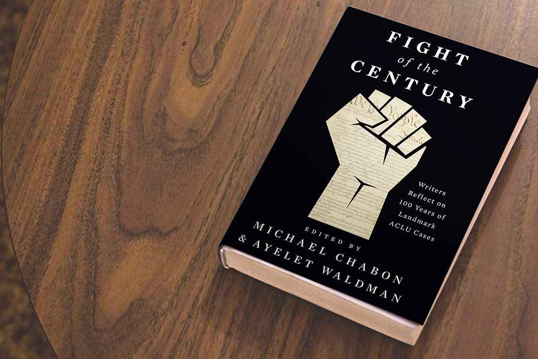 "A black book titled ""Fight of the Century"" edited by Ayelet Waldman and Michael Chabon, lies on a wooden table"