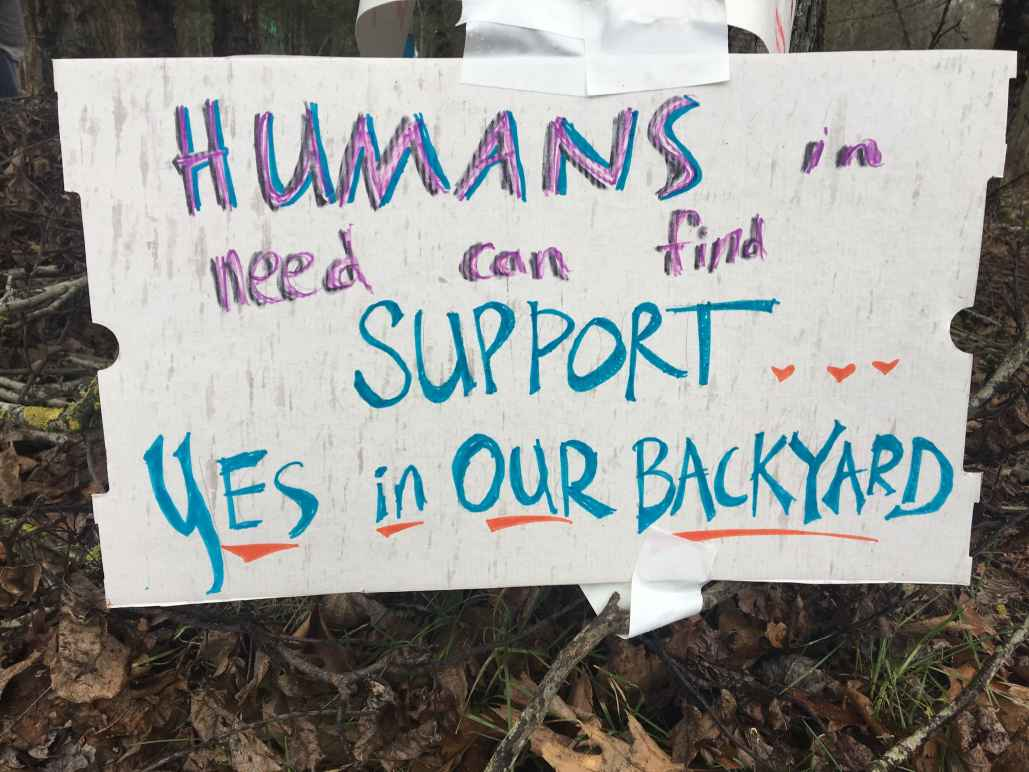 sign reads: Humans in need can find support...yes, in our backyard
