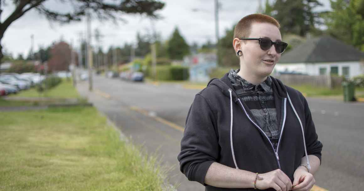 Hailey stands on the side of the road in North Bend, Oregon
